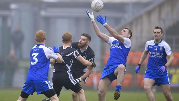Ballinderry midfielder James Conway finds space to catch the high ball