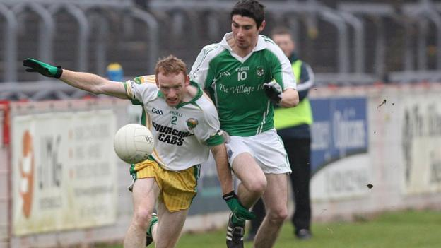 Glenswilly defender Brian McDaid gets a nudge from Niall Cosgrove in the Omagh clash