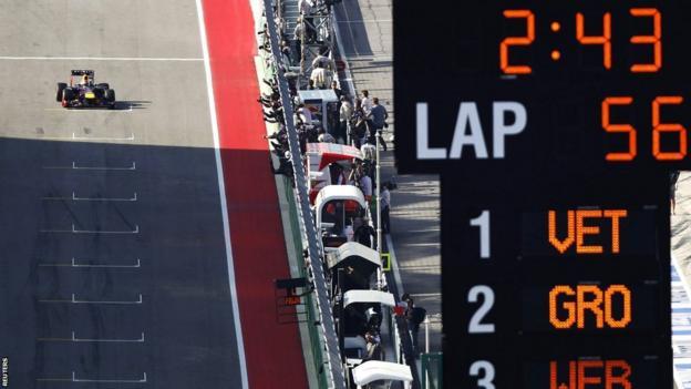Sebastian Vettel crosses the line to win the United States Grand Prix