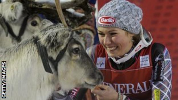 Mikaela Shiffrin is given a reindeer for winning a slalom race in Finland