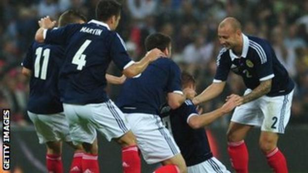 Scotland players celebrating a goal
