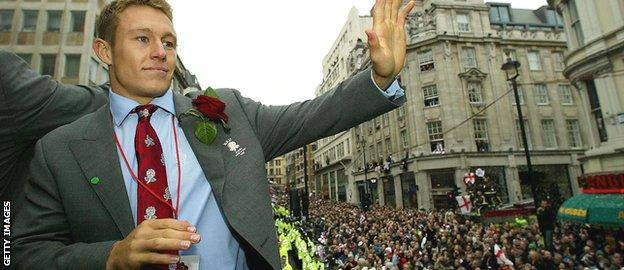 Jonny Wilkinson acknowledges the crowd who turned out to greet England's World Cup winners in London in December 2003