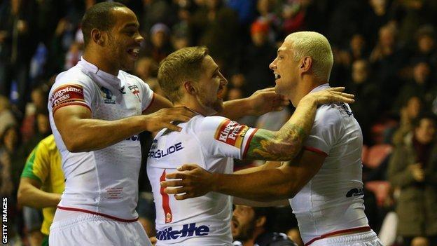 England celebrate a try during the win over France