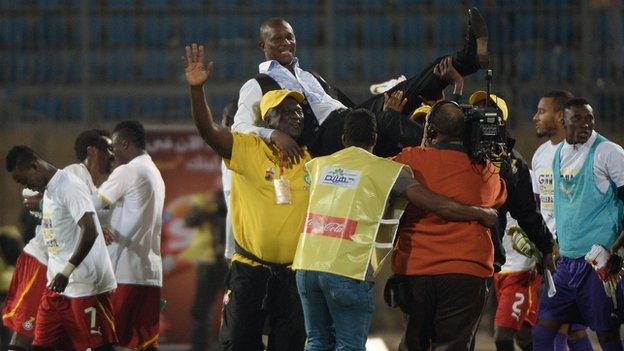 Coach Kwesi Appiah is lifted up high after Ghana qualify for the World Cup in Brazil