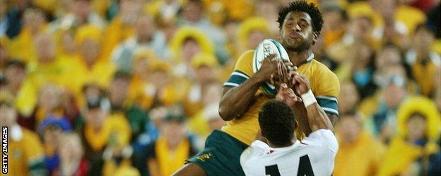 Lote Tuqiri jumps above Jason Robinson to score Australia's try