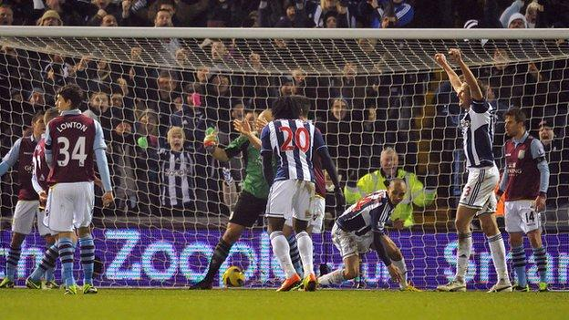 Villa right-back Mattt Lowton looks away in disgust after Peter Odemwingie's late equaliser in January at The Hawthorns