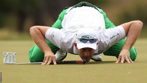 Stuart Manly is a picture of concentration as he finishes the second day of the World Cup of Golf in Melbourne five shots behind Denmark's Thomas Bjorn