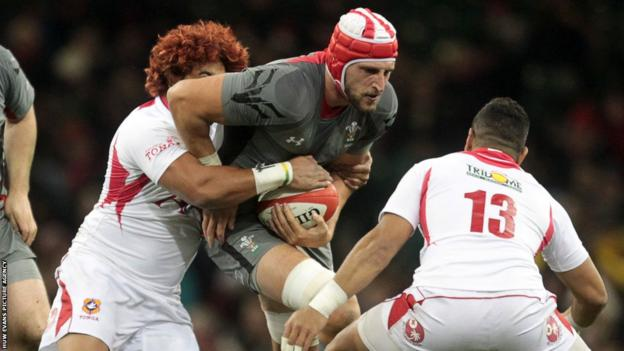 Lock Luke Charteris is tackled by Tonga's Taniela Moa and Siale Piutau during the first half of Wales' third Test of the autumn series in Cardiff