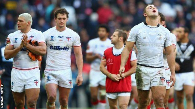 Disconsolate England players after defeat to New Zealand in the 2013 Rugby League World Cup semi-final at Wembley