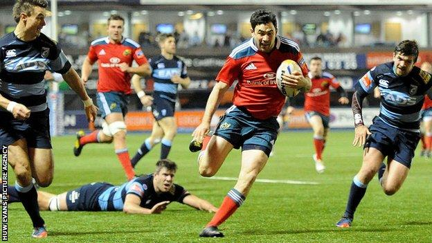 Felix Jones runs in the opening try for Munster against the Cardiff Blues