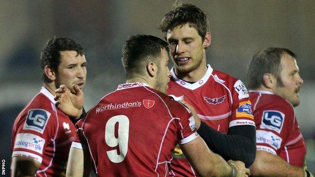 Gareth Davies is congratulated after scoring the third Scarlets try in Galway