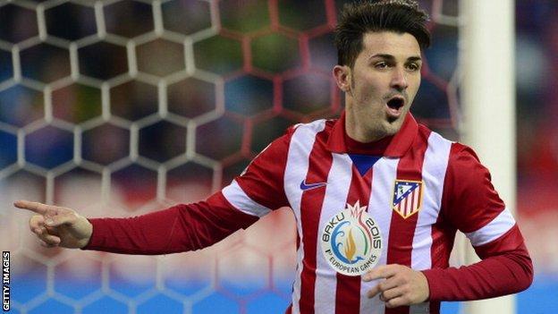 Atletico Madrid forward David Villa celebrates scoring against Getafe