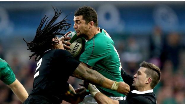 Ma'a Nonu and Cory Jane combine to tackle Ireland full-back Rob Kearney