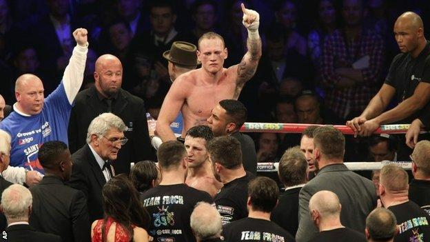 George Groves is held aloft at the end of the fight against Carl Froch
