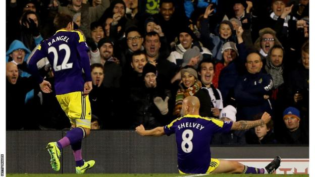 Jonjo Shelvey celebrates in front of the travelling fans after scoring Swansea City's winner against Fulham at Craven Cottage
