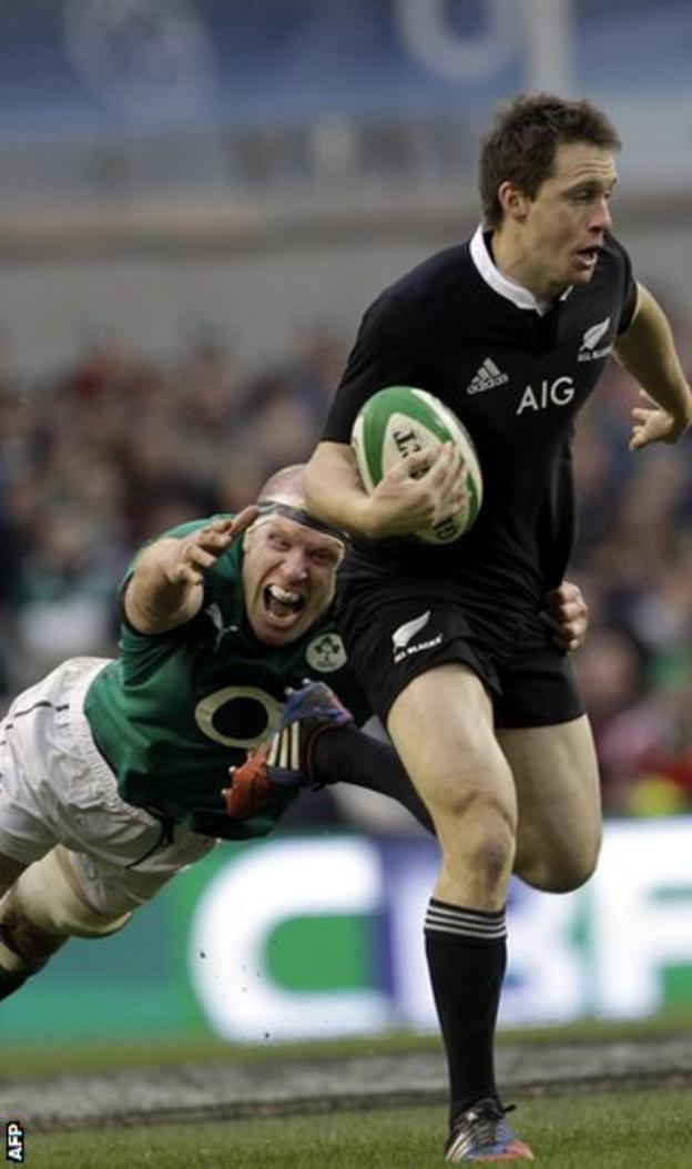New Zealand's Ben Smith in action against Paul O'Connell of Ireland