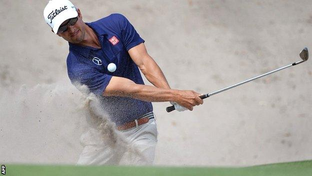 Adam Scott in first-round action at the Australian Open