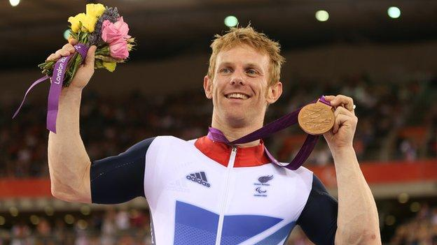 Jody Cundy celebrating his bronze medal at the Paralympics
