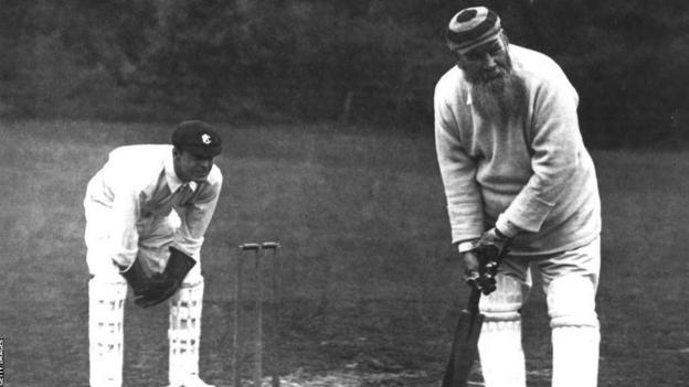 W.G. Grace of Gloucestershire standing at the wicket in 1904