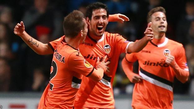 Dani Parejo celebrates Valencia's opener in their Europa League clash at Swansea City
