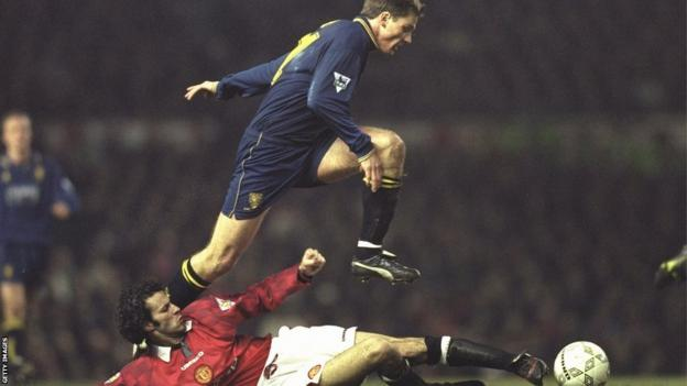 Ryan Giggs scores against Wimbledon during the 1996-97 season.