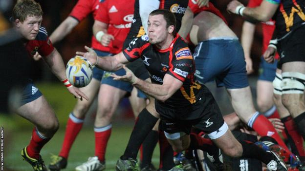 Dragons' Richie Rees feeds the ball out from a scrum