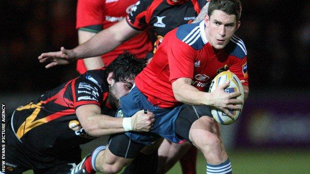 Munster's Ian Keatley is tackled during the win over the Dragons