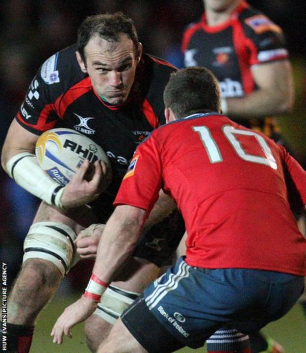 Rob Sidoli takes on Munster's match winner Ian Keatley during Newport Gwent Dragons 14-18 home defeat in the Pro12.