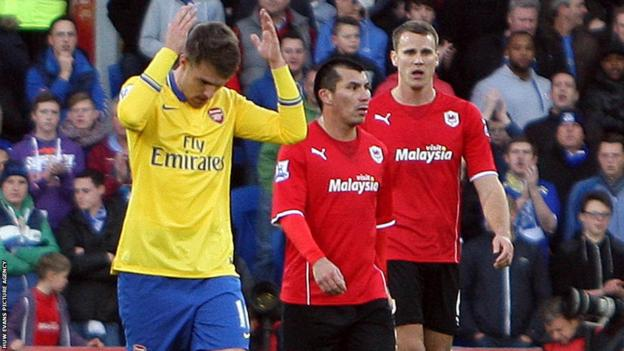 Ramsey performs the Cardiff celebration known as the Ayatollah after scoring his side's opening goal against his former club
