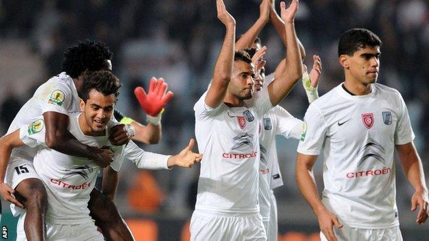 CS Sfaxien players celebrate