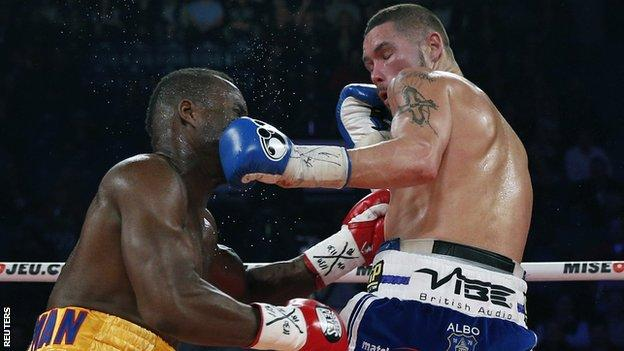 Tony Bellew (left) takes a punch from Adonis Stevenson