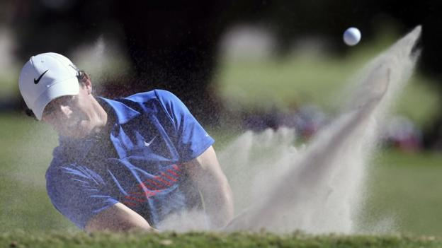 World number six Rory McIlroy plays a bunker shot at the 16th hole during the final day of the Australian Open in Sydney