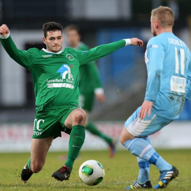 Ballinamallard United's Steve Feeney competes against David Cushley of Ballymena United