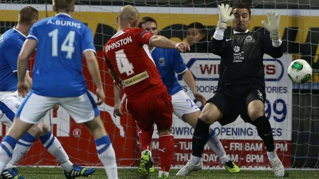 Barry Johnston shoots in Cliftonville's second goal in their 3-0 Premiership win over leaders Linfield