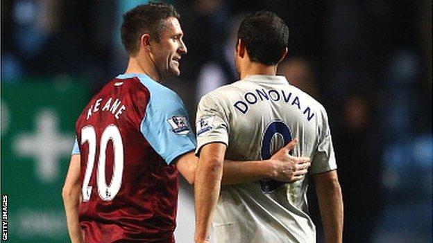 Robbie Keane (left) and Landon Donovan in Premier League action
