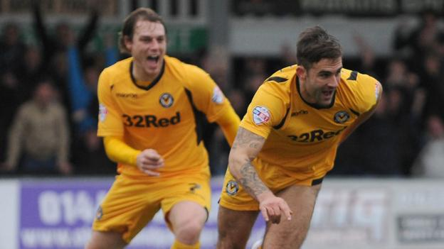Andy Sandell celebrates Newport County's third goal in their 3-2 win over second-placed Chesterfield in League Two
