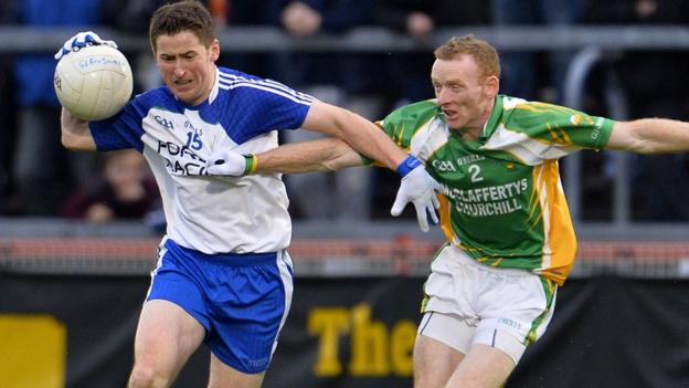 Ballinderry forward Conleth Gilligan holds off the challenge of Glenswilly defender Brian McDaid