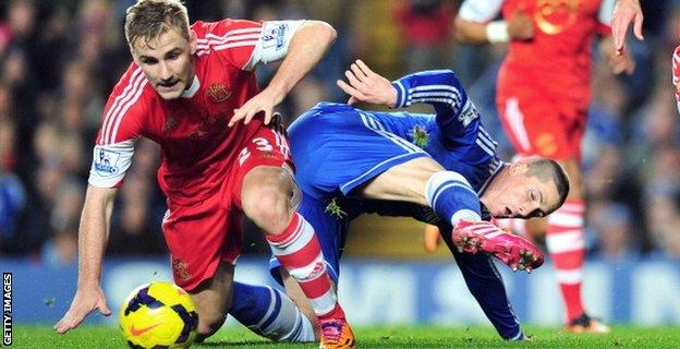 Southampton defender Luke Shaw tussles for the ball with Chelsea striker Fernando Torres