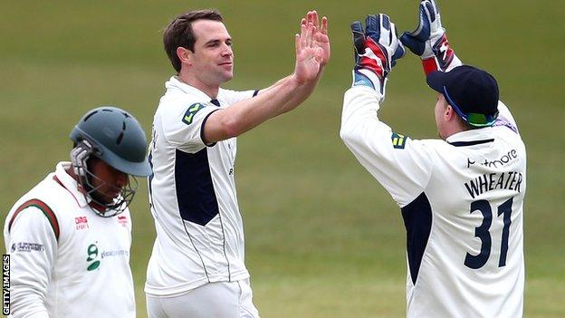 James Tomlinson (centre) takes a wicket for Hampshire
