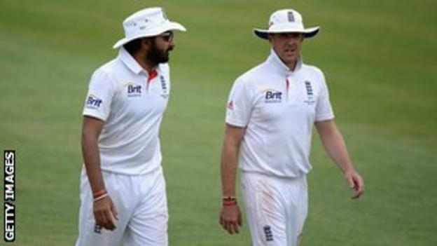 Monty Panesar and Graeme Swann of England leave the field at the end of the first innings during day two of the tour match between the Chairman's XI.