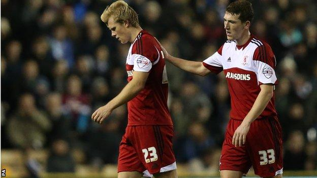 Middlesbrough's Curtis Main (left) is consoled by Richard Smallwood after being sent off at Derby