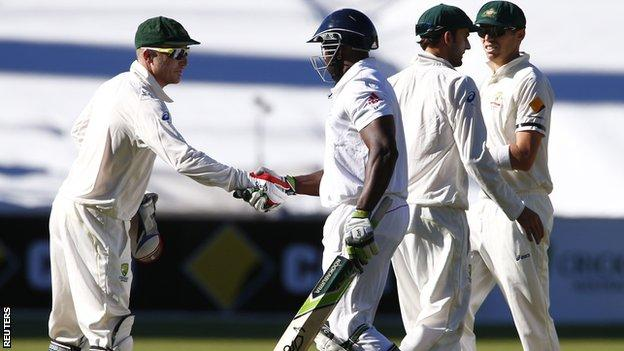 Brad Haddin shakes hands with Michael Carberry after day two