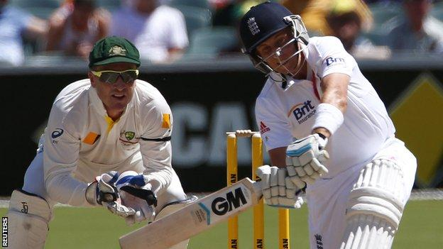 Joe Root plays a slog-sweep shot from which he was caught
