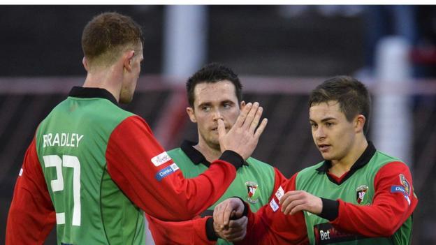 Glentoran goal-scorer Jordan Stewart is congratulated by his team-mates at the Oval