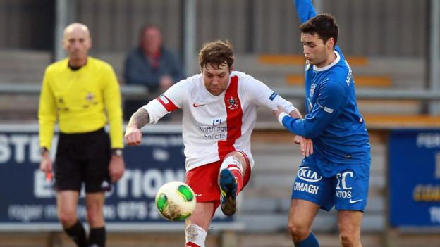 Ryan Henderson shields the ball from Stuart Hutchinson as Ballinamallard beat Ards 1-0 at Ferney Park