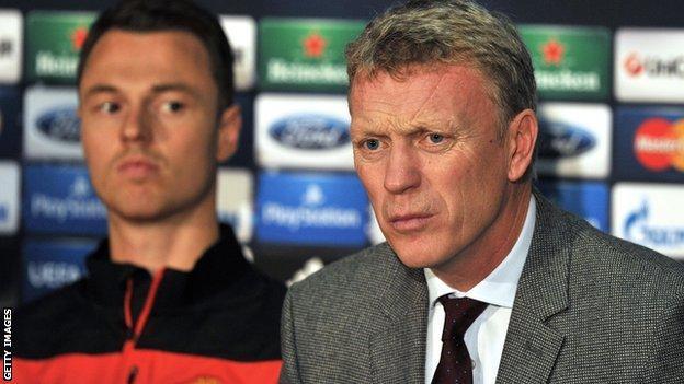 Manchester United defender Jonny Evans (left) and manager David Moyes