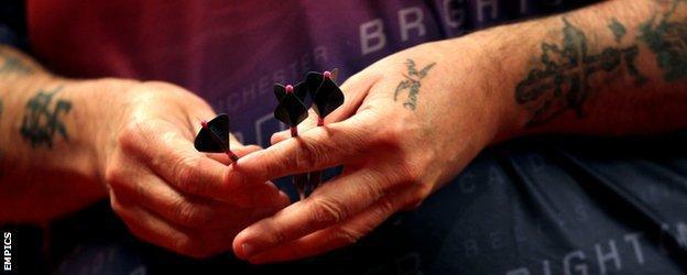 Phil Taylor handles darts