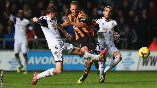 Swansea City defender Ben Davies and Hull City's David Meyler