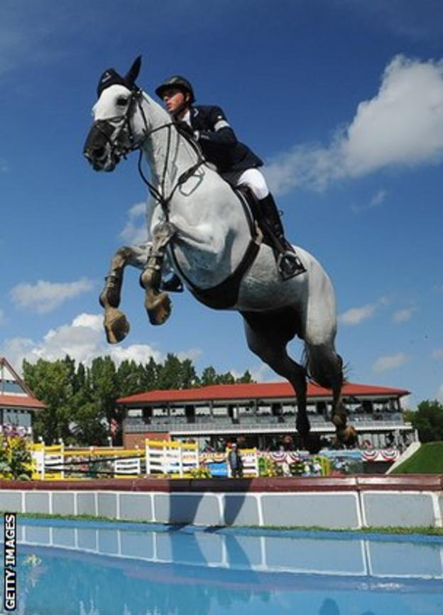 Ben Maher jumps over a water hazard on Cella during a Masters event in Calgary in September