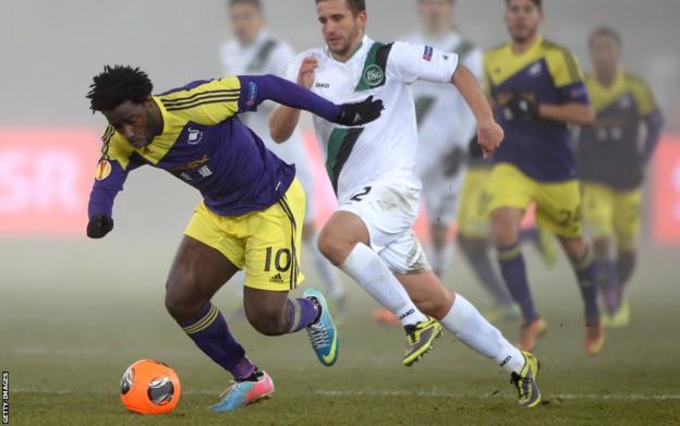 Swansea City striker Wilfried Bony, back in the side following injury, tries to shrug off St Gallen's Muhamed Demiri.
